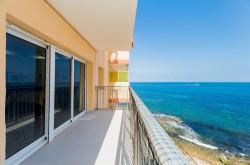Шикарные апартаменты на первой линии моря в Торревьехе